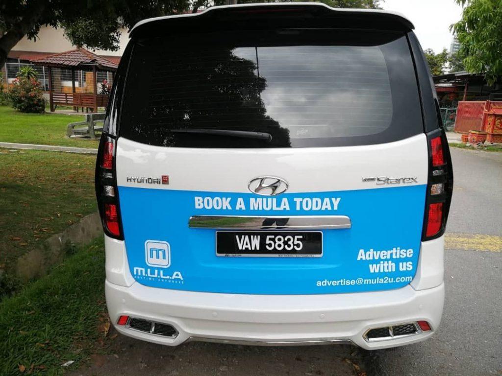 Kuala Lumpur MPV rental executive rear view